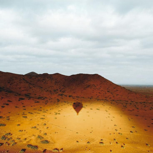 Marrakech Hot Air Balloon shadow reflecting on the desert ground