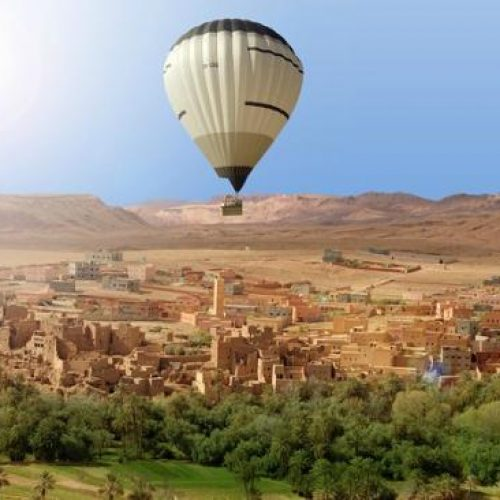 Marrakech Hot Air Balloon flight over a village with view on Atlas mountains